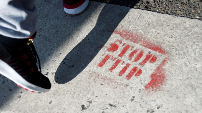 A sprayed sign against the TTIP free trade agreement is pictured in Frankfurt