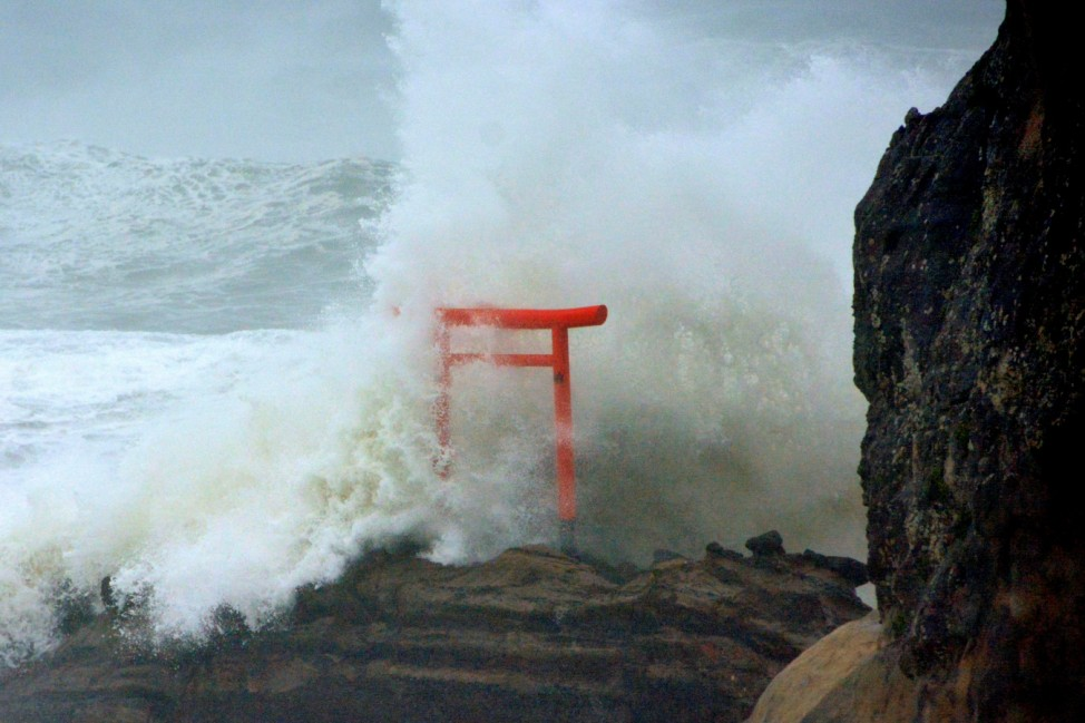 High waves triggered by Typhoon Lionrock crash against a 'torii' gate on a coast of the city of Iwaki, Fukushima Prefecture, Japan