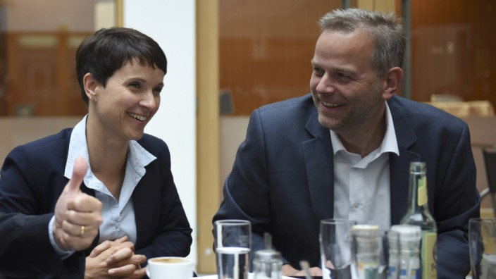 Frauke Petry, chairwoman of the anti-immigration party Alternative for Germany (AfD), and Leif-Erik Holm, Mecklenburg-Vorpommer top candidate talk prior to  a press conference in Berlin
