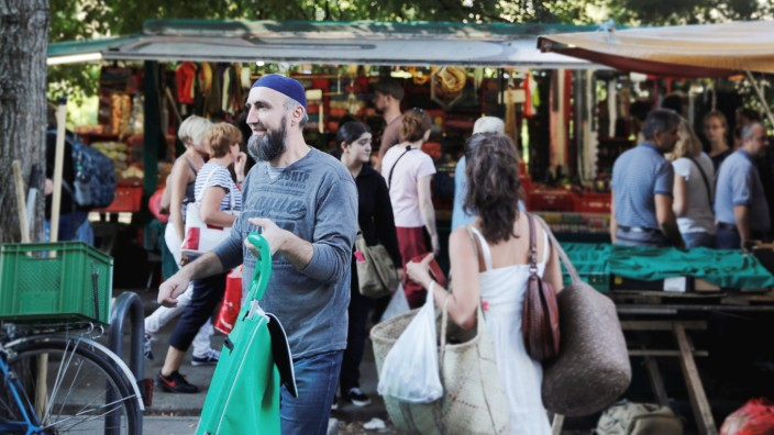 People visit a market in Berlin's Kreuzberg district