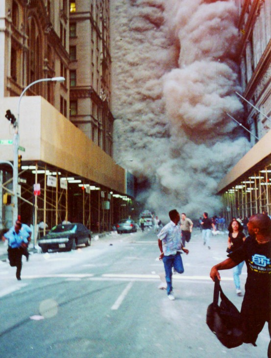 PEOPLE RUN DOWN BROADWAY AWAY FROM COLLAPSING WORLD TRADE CENTER
