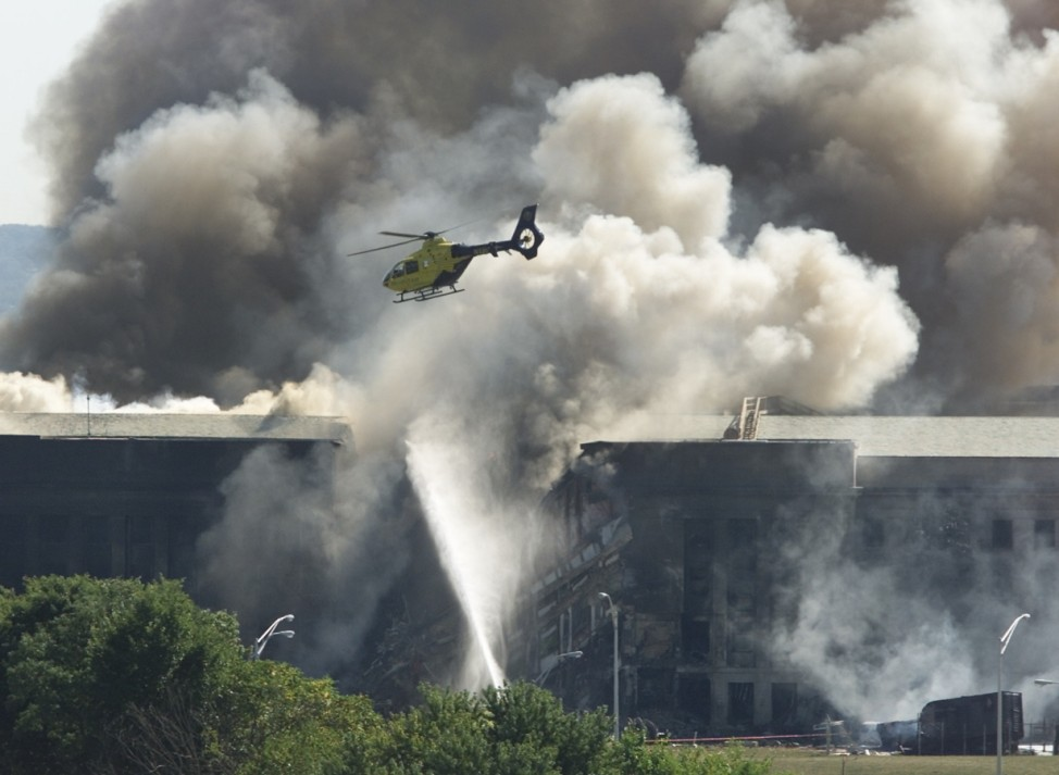RESCUE HELICOPTER FLIES OVER AREA AT PENTAGON HIT BY AIRPLANE