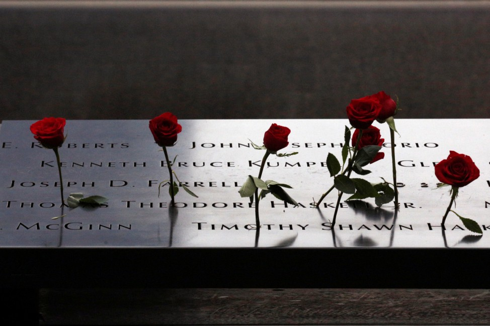 Roses are placed on names on the memorial during the ceremony marking the 15th anniversary of the attacks  on the World Trade Center at The National September 11 Memorial and Museum in New York