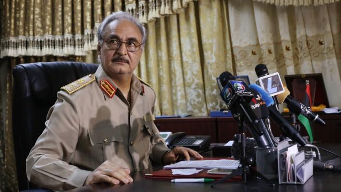 General Khalifa Haftar attends a news conference at Benina air base in Benghazi
