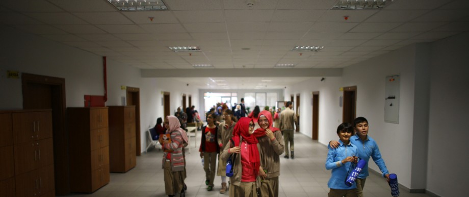 Students of Tevfik Ileri Imam Hatip School walk along a corridor as they leave their classroom for a break in Ankara