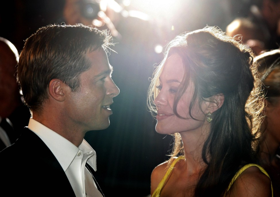 Actor Brad Pitt and Angelina Jolie leave the world premiere of US director Steven Soderbergh's film 'Ocean's 13' at Cannes