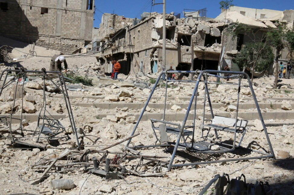 Swings are seen in a damaged site after airstrikes on the rebel held Tariq al-Bab neighbourhood of Aleppo