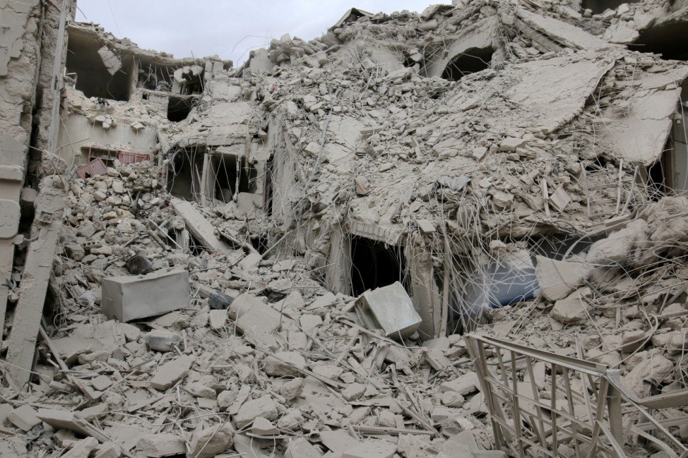 A damaged site is pictured after airstrikes on the rebel held Tariq al-Bab neighbourhood of Aleppo