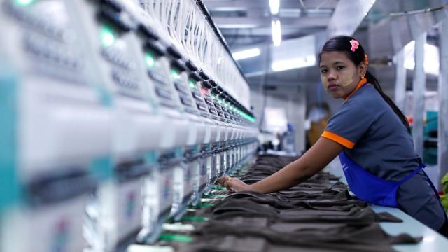 A labourer works at a garment factory in Bangkok