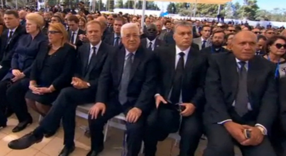 A still image from video showing Palestinian President Mahmoud Abbas at funeral of former Israeli President Shimon Peres in Jerusalem