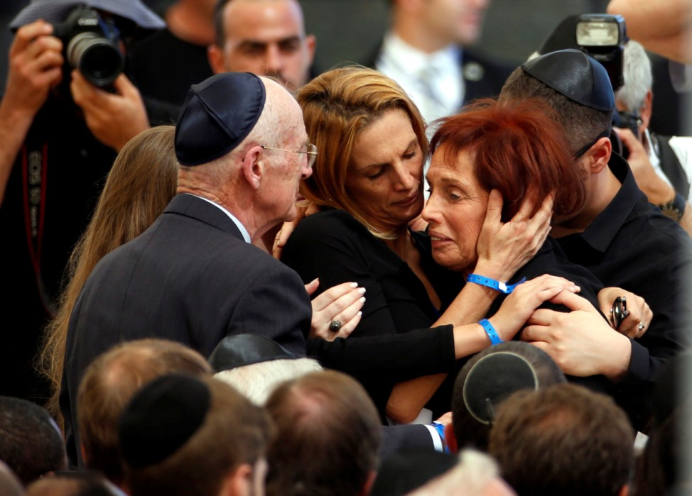 Tsvia, the daughter of former Israeli President Shimon Peres is comforted by her family as she mourns during her father's funeral ceremony at Mount Herzl cemetery in Jerusalemm