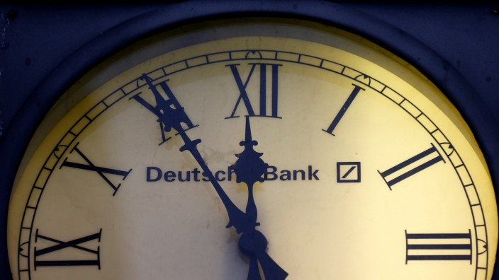 A vintage clock with the logo of Deutsche Bank is pictured outside the bank's branch in Wiesbaden