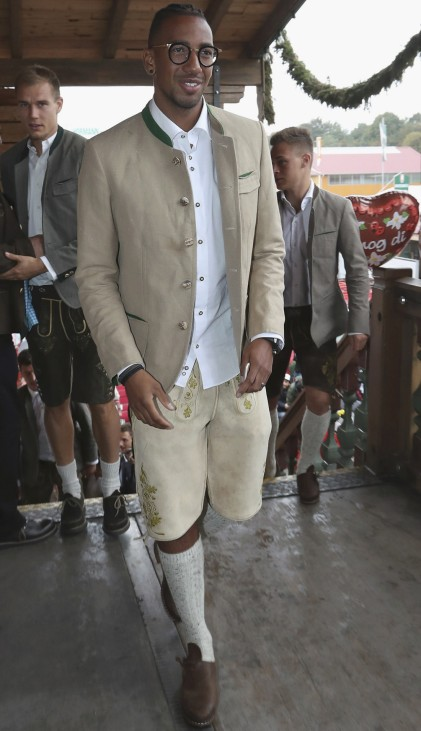 Jerome Boateng of FC Bayern Munich poses during their visit at the Oktoberfest in Munich