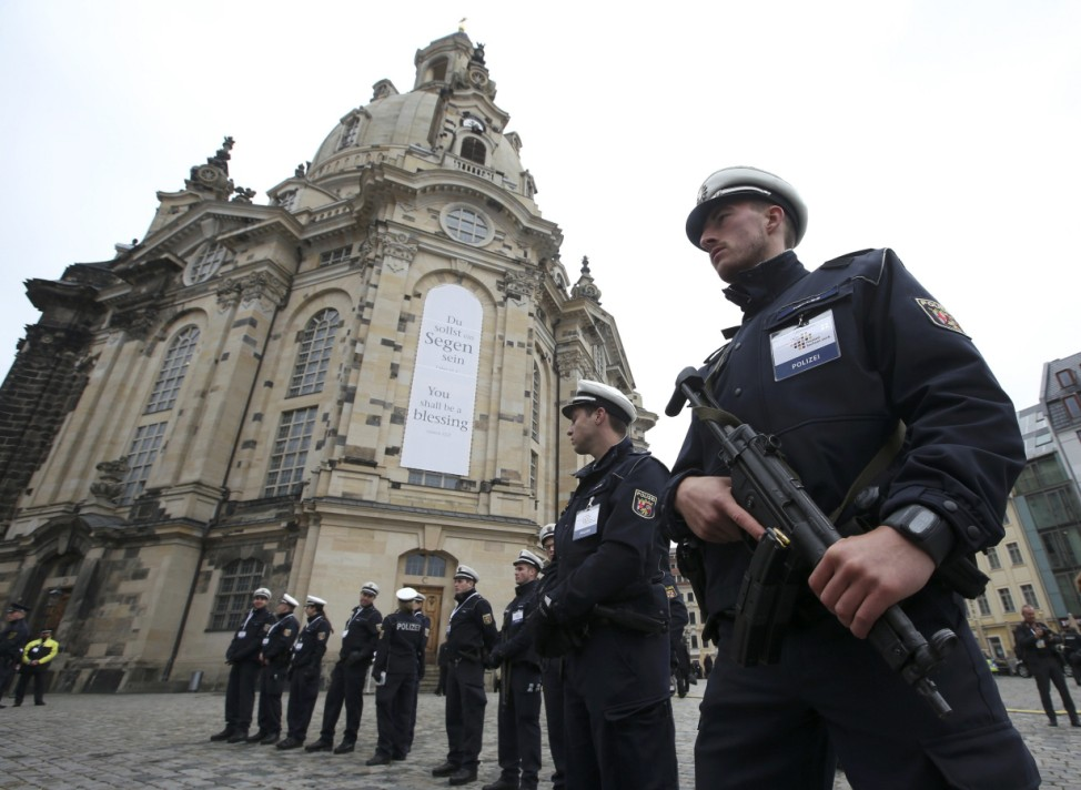 German police line up in front of Frauenkirche cathedral during celebrations marking the German Unification Day in Dresden