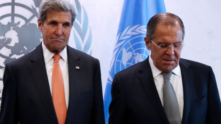 U.S. Secretary of State Kerry and Russian Foreign Minister Lavrov pose for a photo before a Middle East Quartet Principals Meeting during 71st Session of the United Nations General Assembly in New York