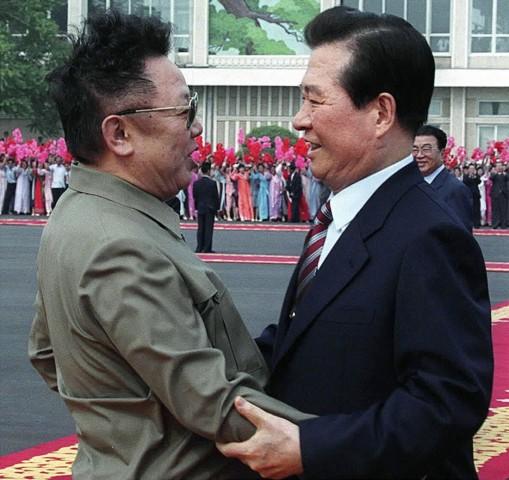 File photo of North Korean leader Kim Jong-il and South Korean President Kim Dae-jung embracing at Sunan airport