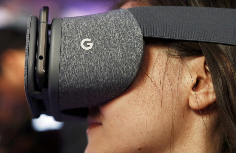 A member of the media tries out the Google Daydream View VR headset during the presentation of new Google hardware in San Francisco