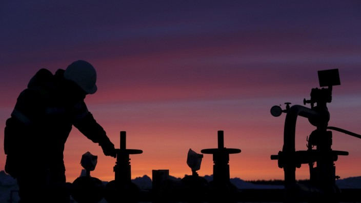 File photo of a worker checking the valve of an oil pipe at an oil field owned by Bashneft company near Nikolo-Berezovka