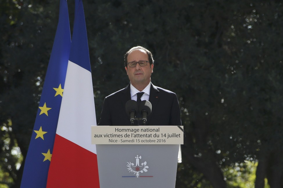French President Hollande attends the ceremony in tribute to them and the families of the fatal truck attack three months ago, in NIce