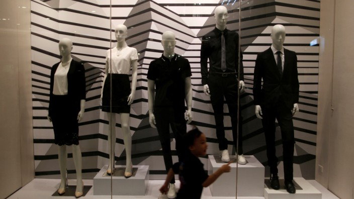 Mannequins are dressed in black and white as retailers pay their respects to Thailand's late King Bhumibol Adulyadej, at a shopping mall in Bangkok