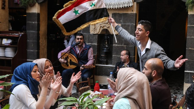 DAMASCUS SYRIA APRIL 2 2016 People in a restaurant in the Syrian capital Damascus Valery Shari