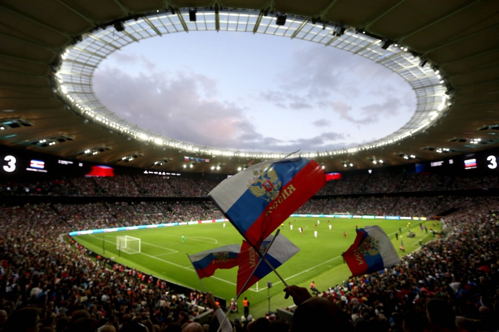 KRASNODAR RUSSIA OCTOBER 9 2016 Russia s fans wave Russian flags as they root for their team in