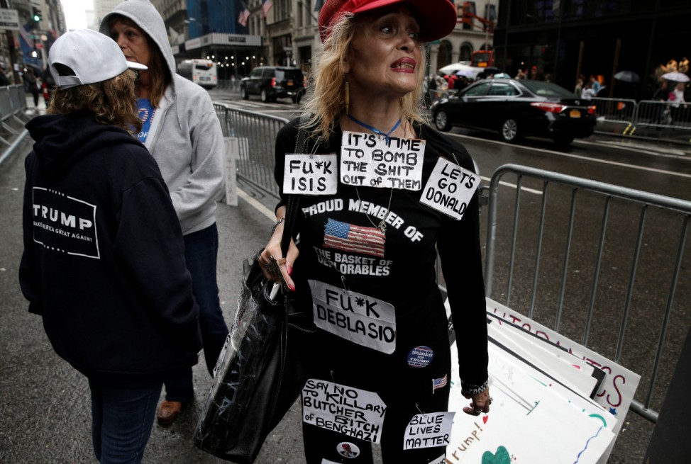 A supporter of Republican presidential nominee Donald Trump stands outside Trump Tower where Trump lives, in the Manhattan borough of New York