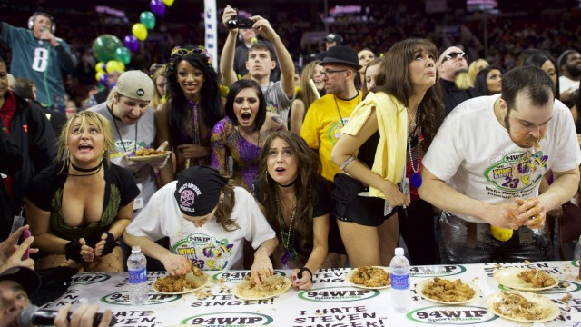 Defending champion Molly Schuyler (2nd L) and Patrick 'Deep Dish' Bertoletti (R) compete in the 23rd annual Wing Bowl at the Wells Fargo Center in Philadelphia, Pennsylvania