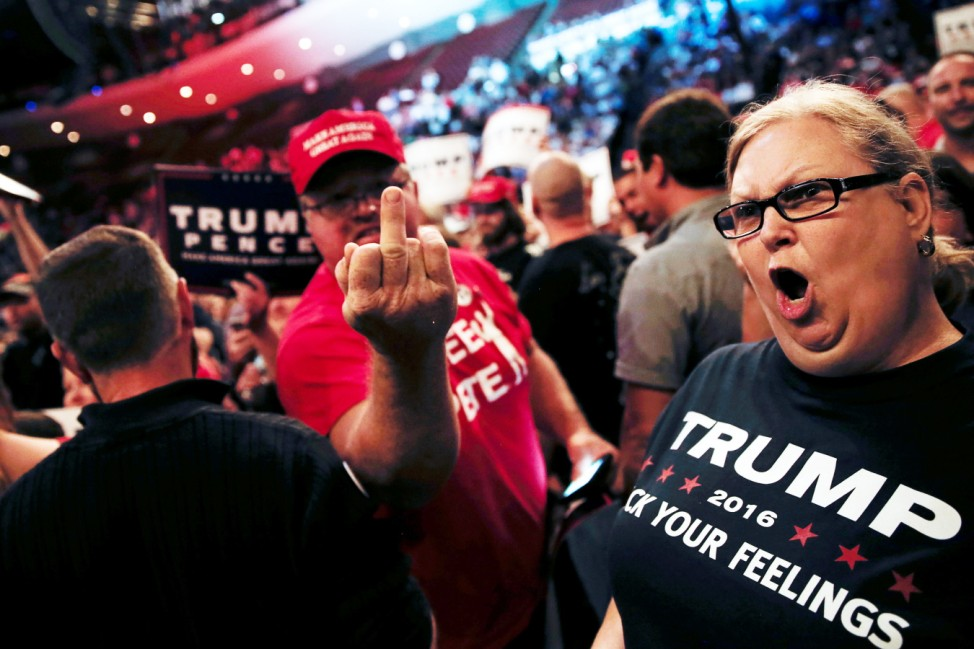 Supporters of Republican U.S. presidential nominee Donald Trump scream and gesture at members of the media in a press area at a campaign rally in Cincinnati