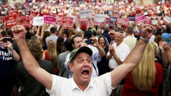 A supporter of Republican presidential nominee Donald Trump yells at the media during a campaign event in Concord
