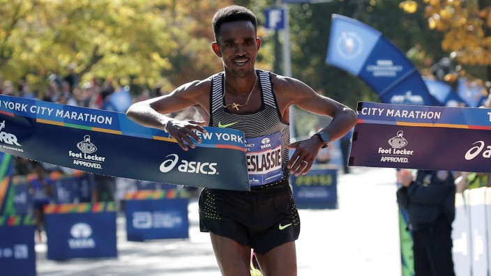 Ghebreslassie of Eritrea crosses the finish line to win the men's field of the 2016 New York City Marathon in Central Park in New York City