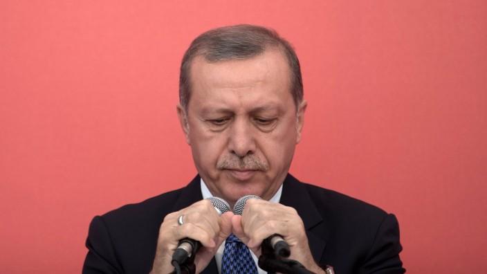 Turkish President Erdogan files criminal complaint against main o