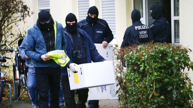 German special police leave a house in Bonn