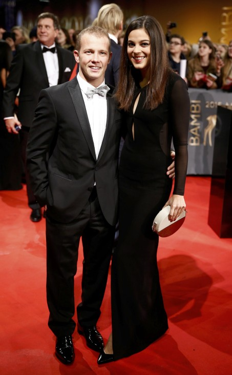 Germany's gymnastics Olympic Gold medalist Hambuechen and his girlfriend Marcia arrive on the red carpet for the Bambi 2016 media awards ceremony in Berlin