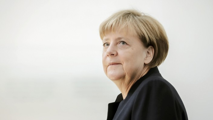 German Chancellor Merkel arrives to sign a book of condolence for former Israeli President Peres in Berlin