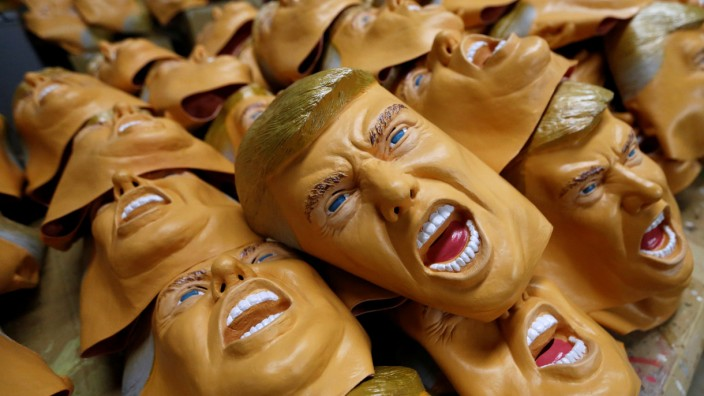 Rubber masks depicting U.S. President-elect Donald Trump are seen at the Ogawa Studios, a mask making company, in Saitama
