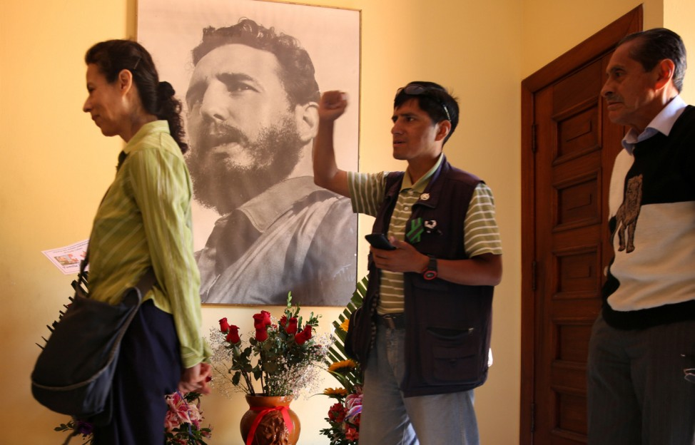 People gather to pay tribute to Cuban revolutionary leader Fidel Castro following the announcement of his death inside the Cuban embassy in Lima