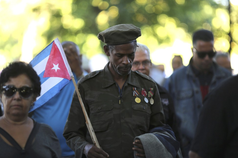 A man wearing medals on his uniform stands in line to pay tribute to Cuba's late President Fidel Castro in Revolution Square in Havan