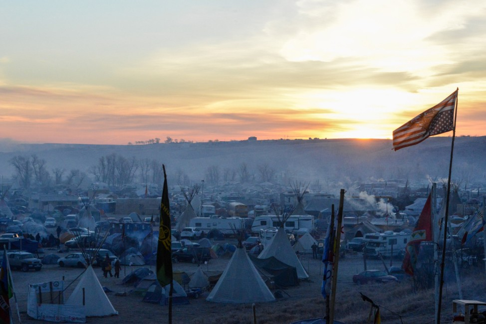 The Oceti Sakowin camp is seen at sunrise during a protest against plans to pass the Dakota Access pipeline near the Standing Rock Indian Reservation, near Cannon Ball, North Dakota, U.S.