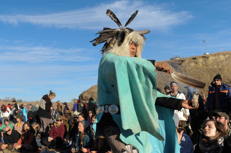 A man from the Havasupai tribe blesses people participating in a prayer circle near Turtle Island during a protest against plans to pass the Dakota Access pipeline near the Standing Rock Indian Reservation, near Cannon Ball, North Dakota