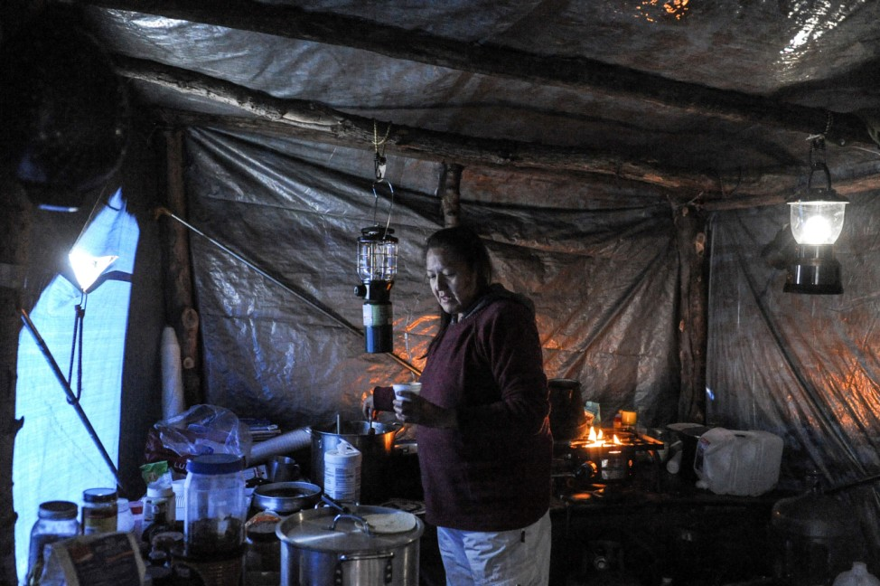 Lelani Running Bear makes breakfast in the Oceti Sakowin camp during a protest against plans to pass the Dakota Access pipeline near the Standing Rock Indian Reservation, near Cannon Ball, North Dakota, U.S.