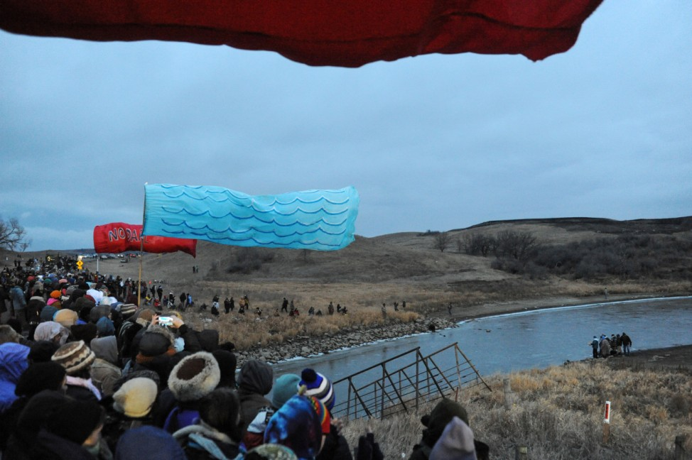 Religious leaders go to the river while protesters watch from Backwater Bridge during a protest against plans to pass the Dakota Access pipeline near the Standing Rock Indian Reservation, near Cannon Ball, North Dakota