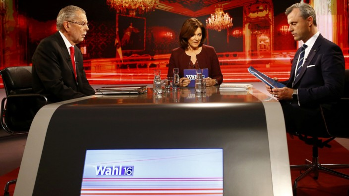 Austrian presidential candidate Van der Bellen, who is supported by the Greens, presenter Thurnher and Hofer of the FPOe prepare for a TV discussion in Vienna