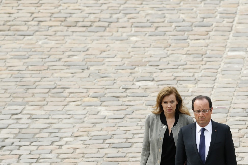 File photo of  French President Hollande and his companion Trierweiler in Paris