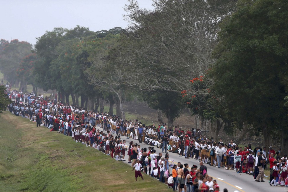People wait for the arrival of the caravan carrying the ashes of Cuba's late President Fidel Castro in Contramaestre