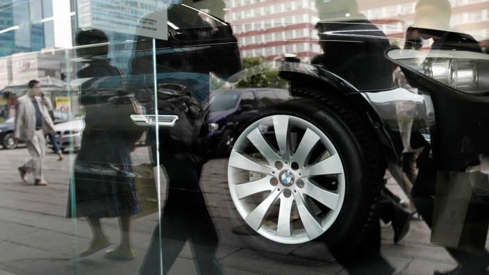 A BMW car is displayed inside a dealership in central Beijing