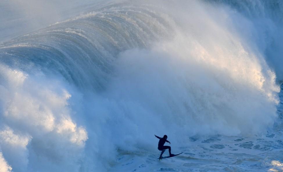 German big wave surfer Sebastien Steutner drops a wave off Praia do Norte in Nazare, central Portugal,