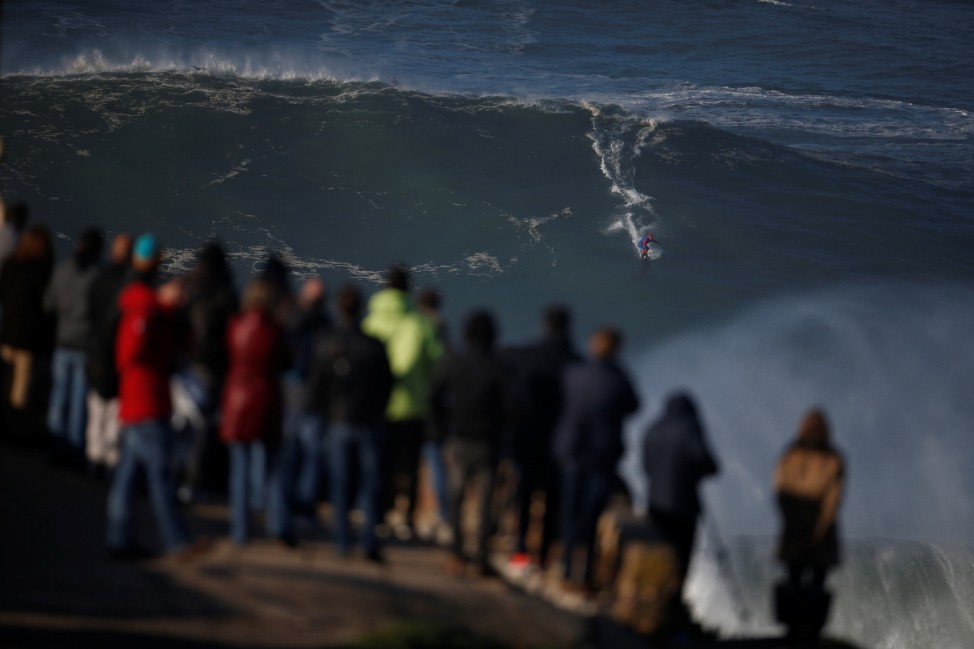 French Brazilian surfer Eric Xavier drops in on a large wave at Praia do Norte in Nazare