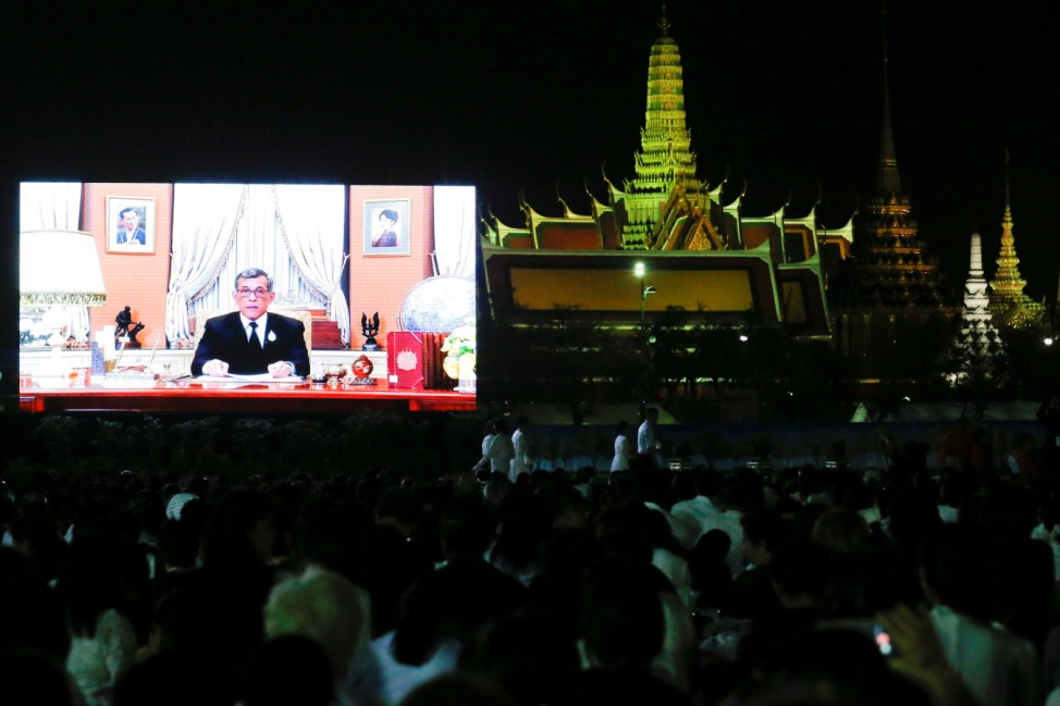 Thailand's new King Maha Vajiralongkorn Bodindradebayavarangkun is seen on a screen as he delivers a speech to Thais to celebrate new year at the Sanam Luang park, Bangkok