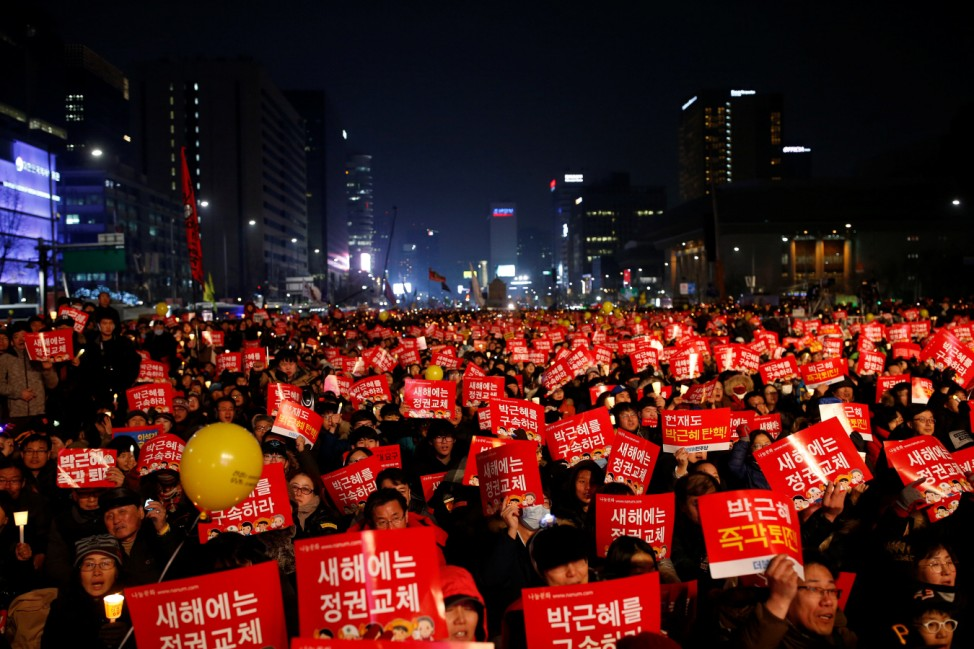 People attend a protest demanding South Korean President Park Geun-hye's resignation in Seoul